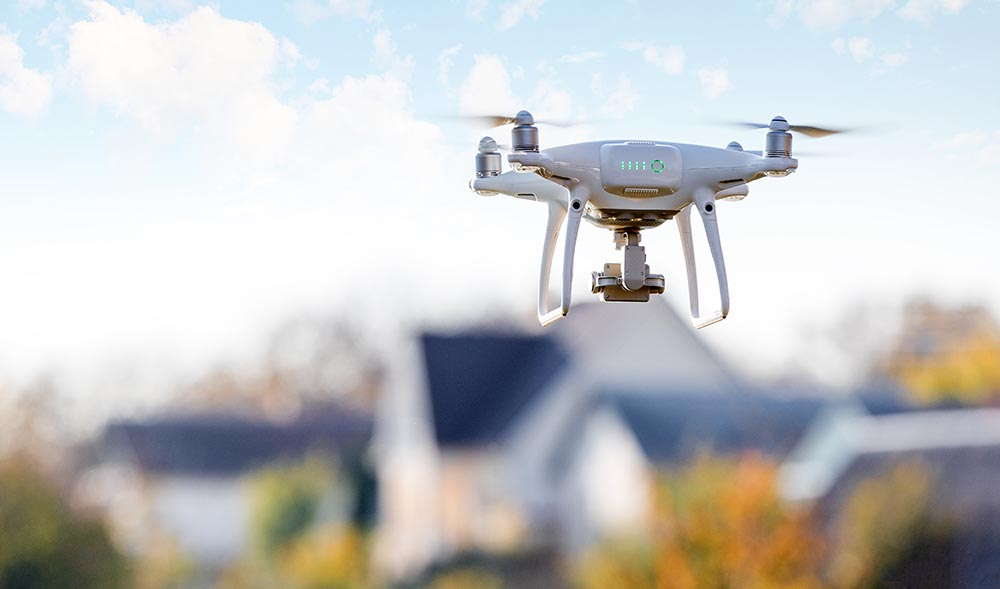 Drone flying over a neighborhood during a home inspection