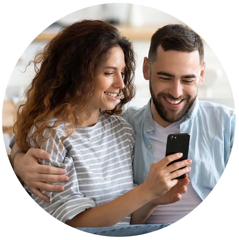 Couple using a smartphone to view their online home inspection report