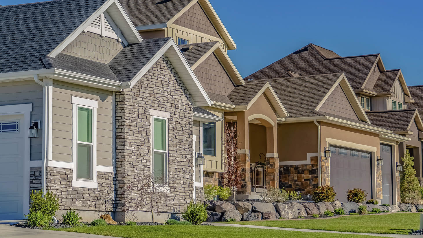 Row of newly constructed houses seen while preforming home inspection services