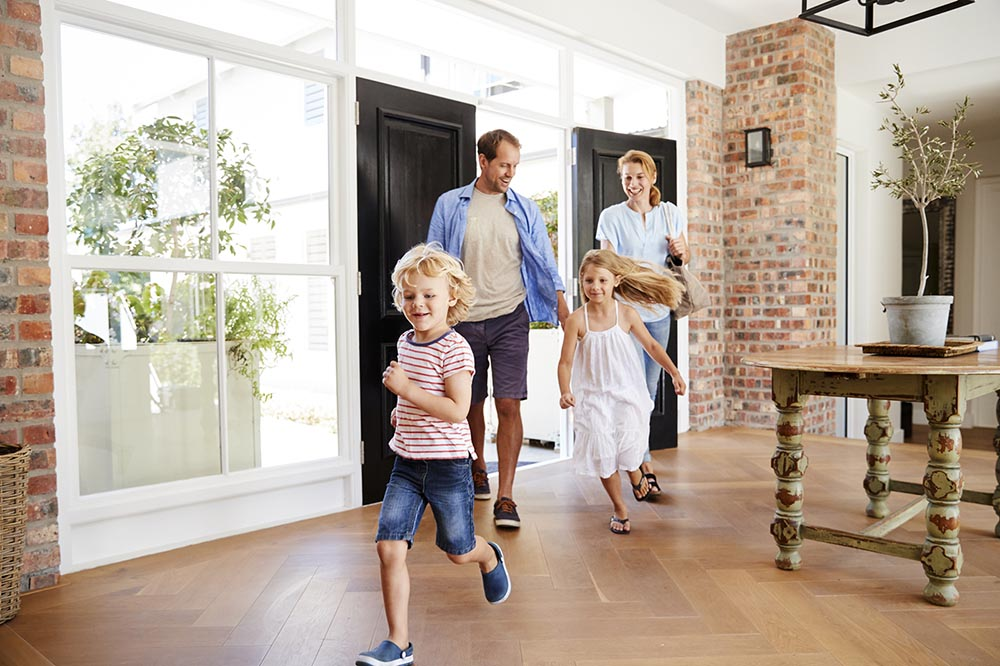 Family of four arriving to their new house after being inspected by our home inspectors